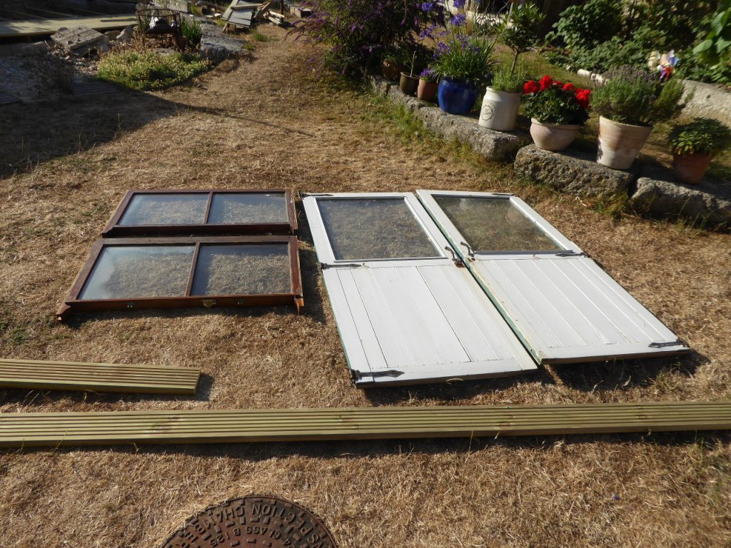 Doors from old beach hut and windows from skip
