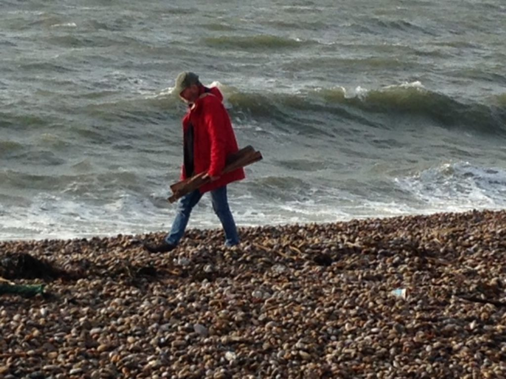 Neil collecting driftwood