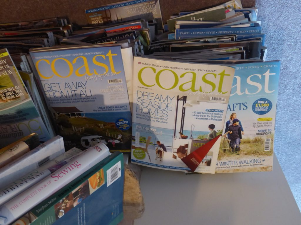Stack of Coast Magazine