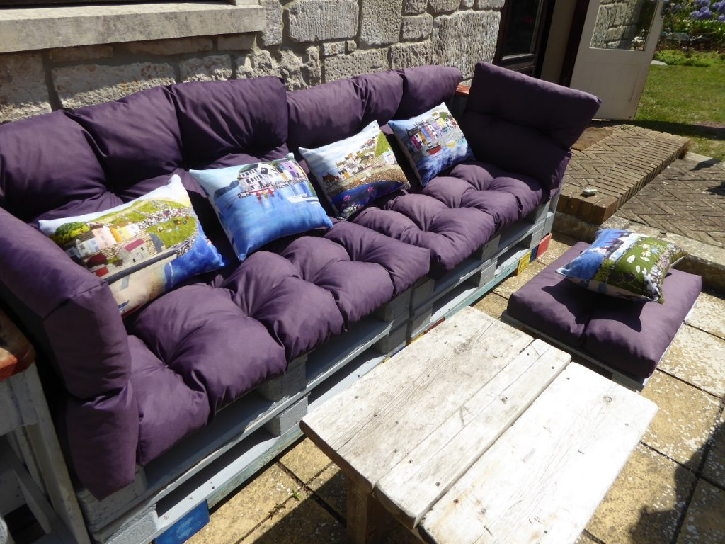 Some of my cushions on the pallet sofa in the garden